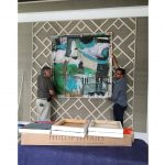 An Ashley Andrew's painting being installed in […]